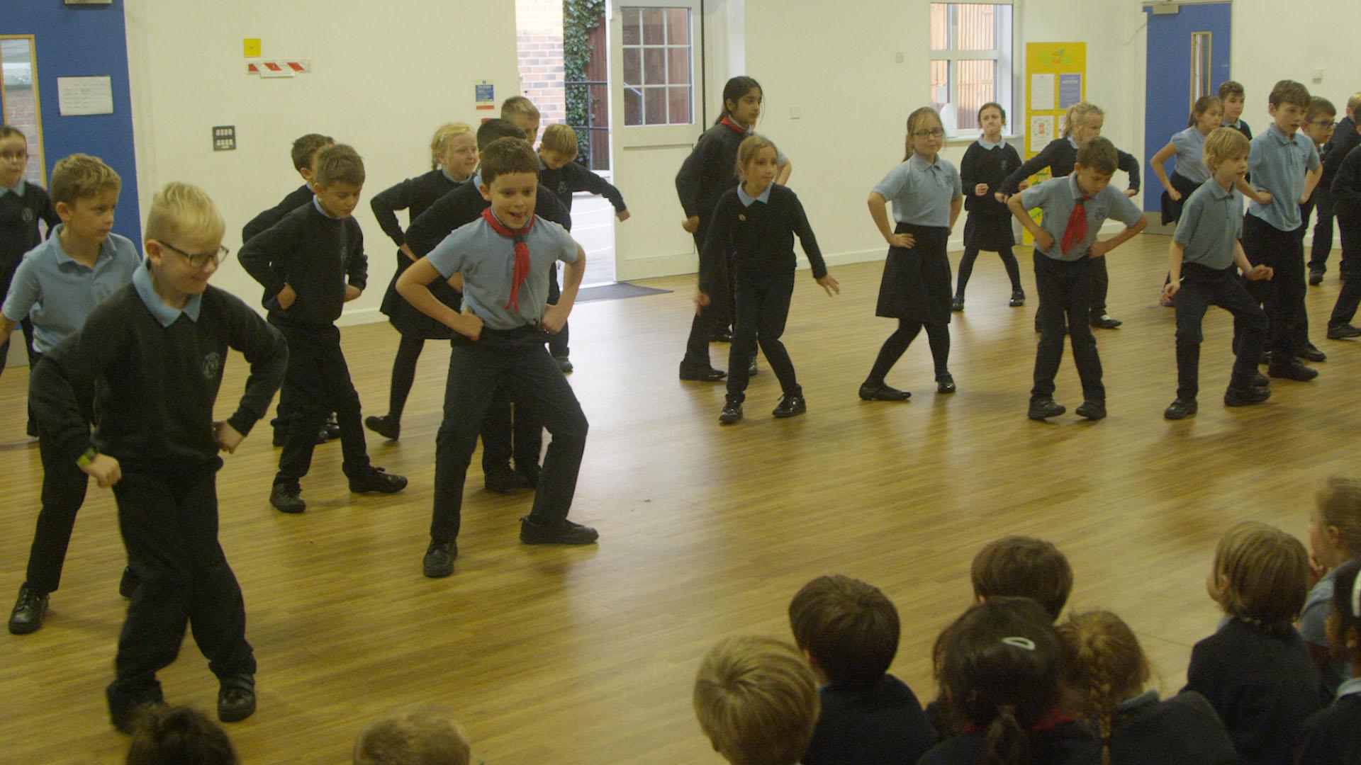 Children learning Cossack Dance