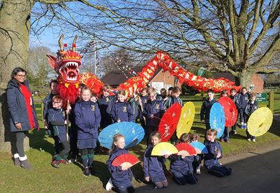 group of people chinese dragon dancing