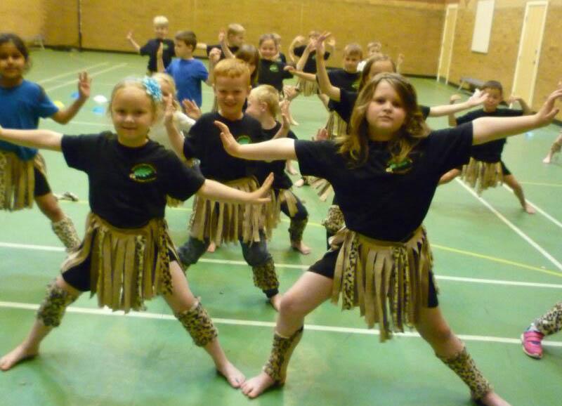 Children dancing in African dance costumes