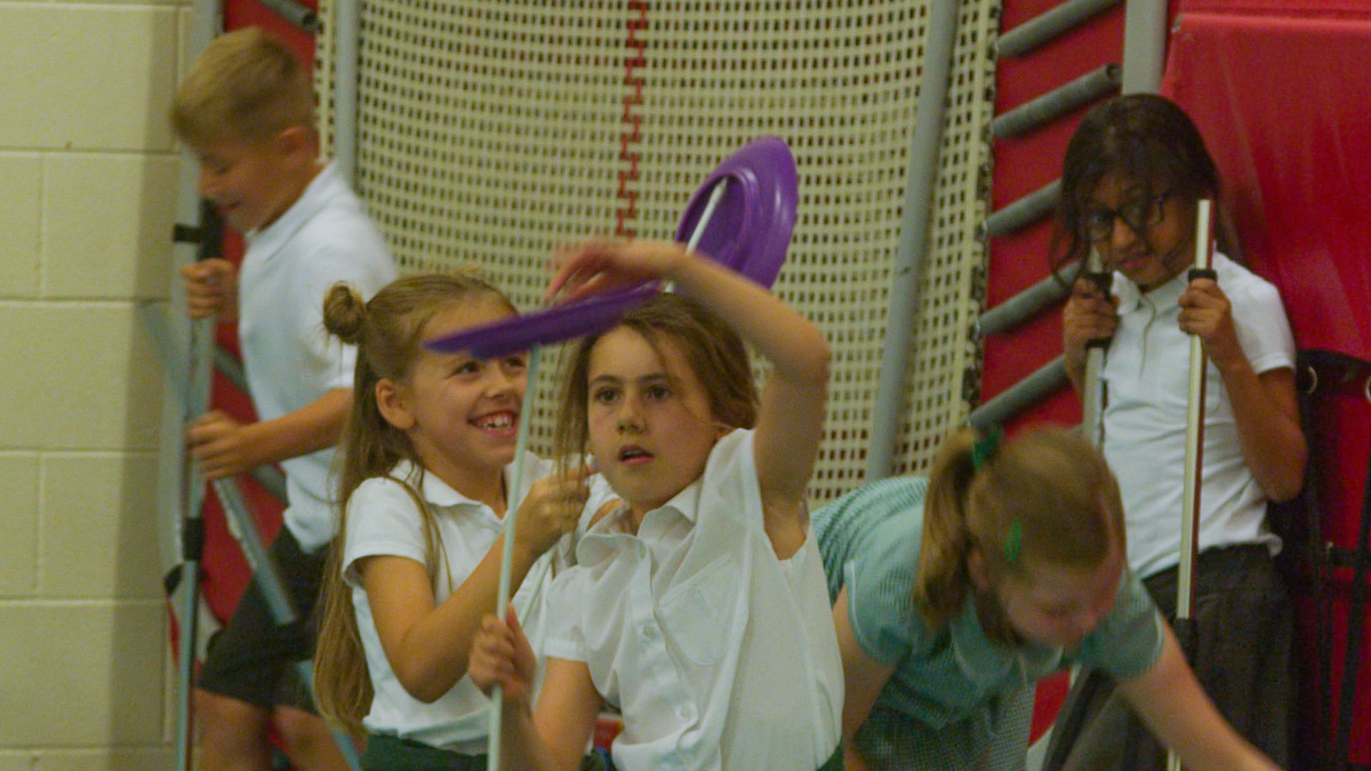 School children balancing purple plate in circus workshop