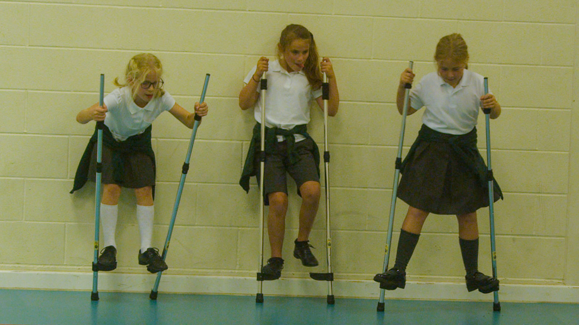 School children using stilts