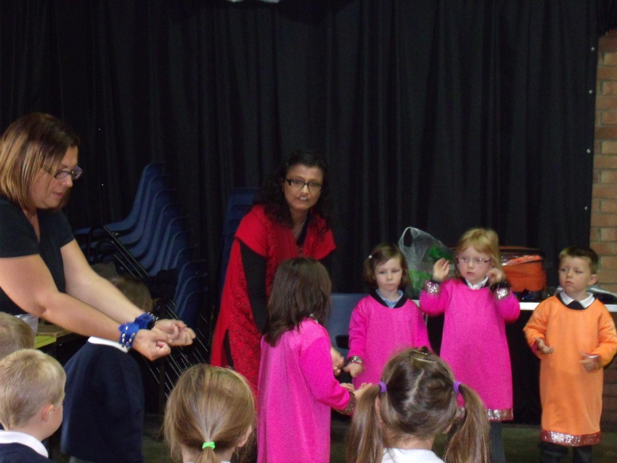 Children being taught Indian dance by teacher