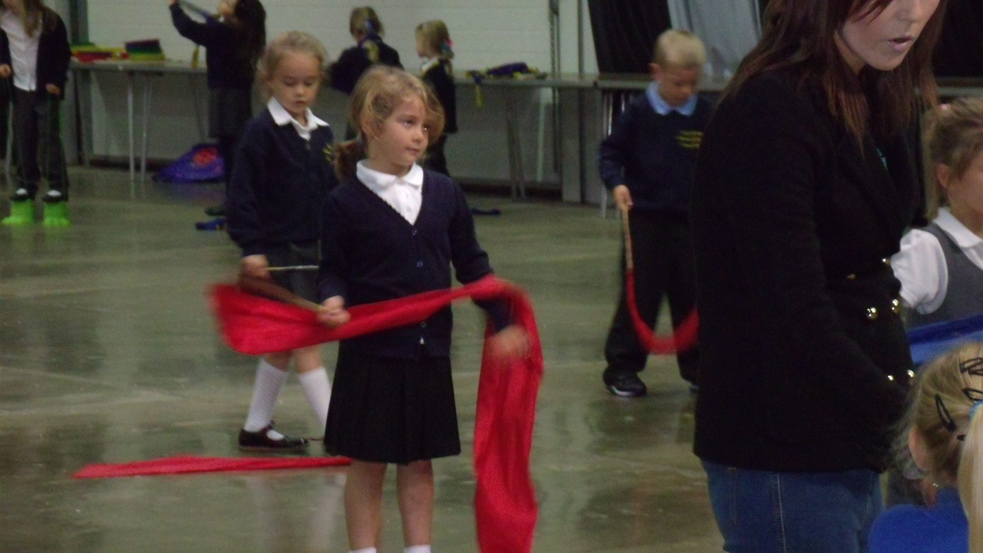 School children holding chinese dance ribbon