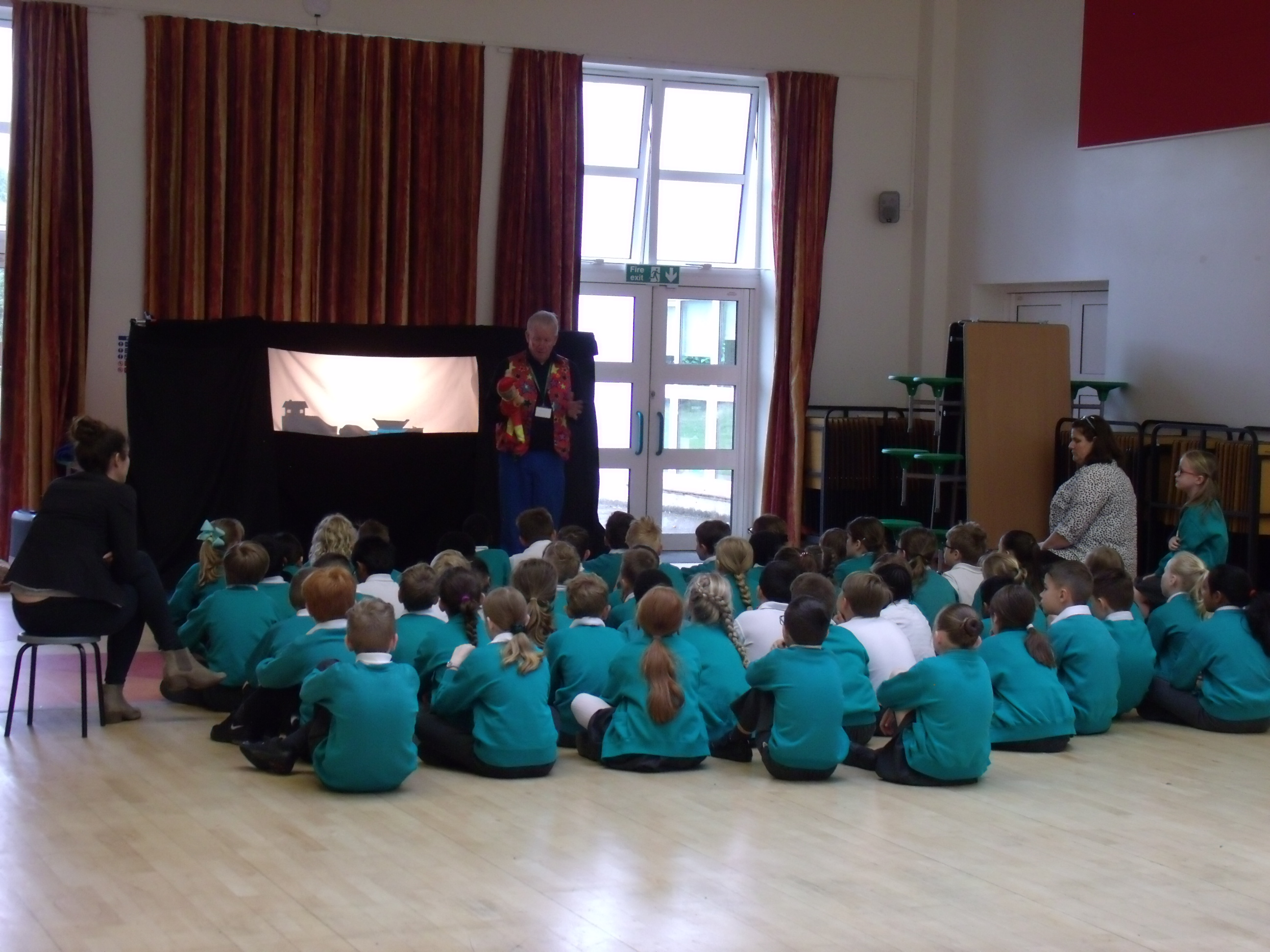 Teacher demonstrating shadow puppetry that the children have made