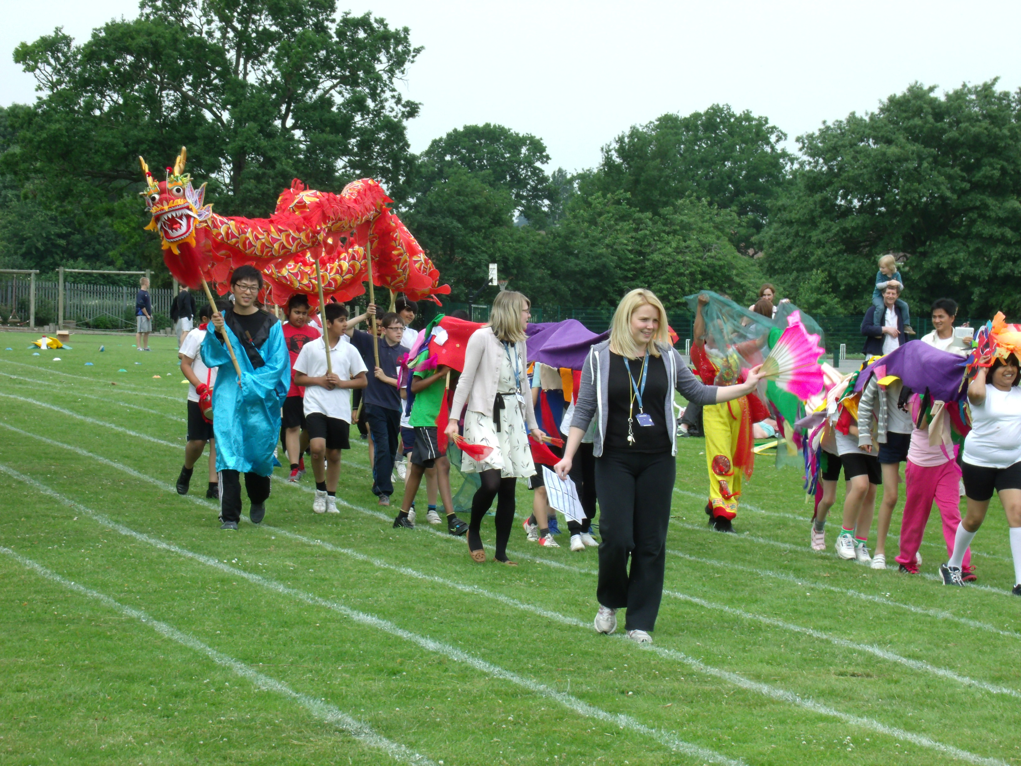 Chinese dragon dancing on school playing field
