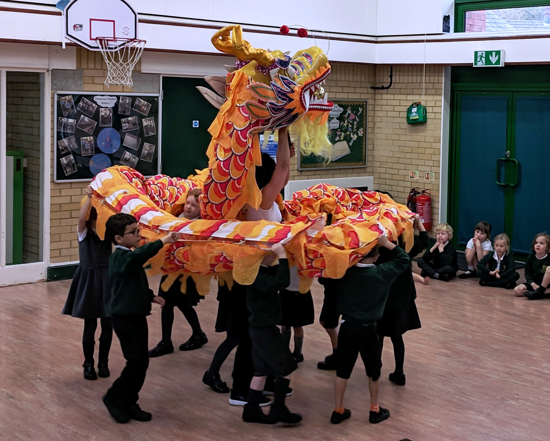 Chinese dragon dancing in school hall