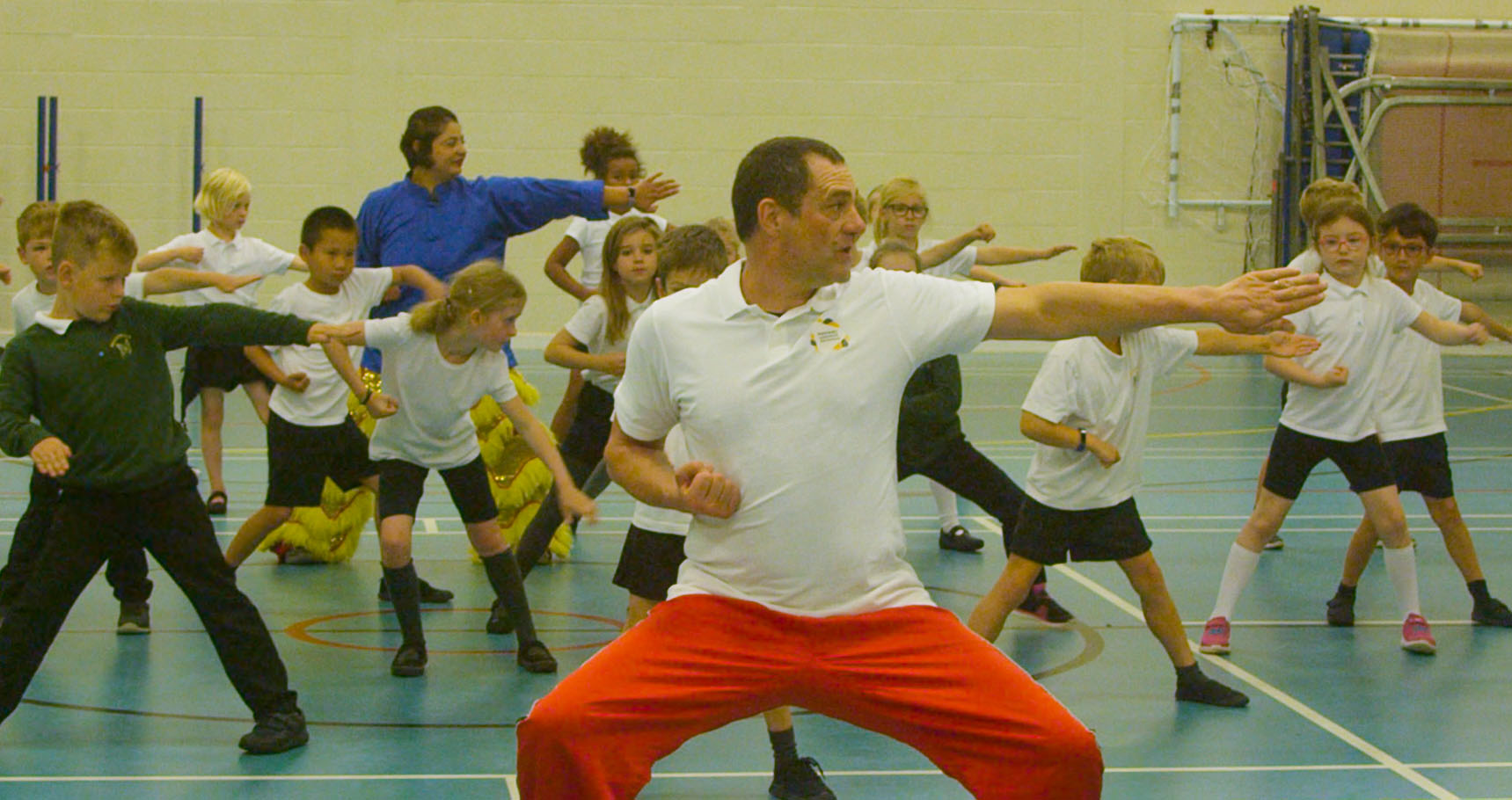 Children and teacher performing martial arts