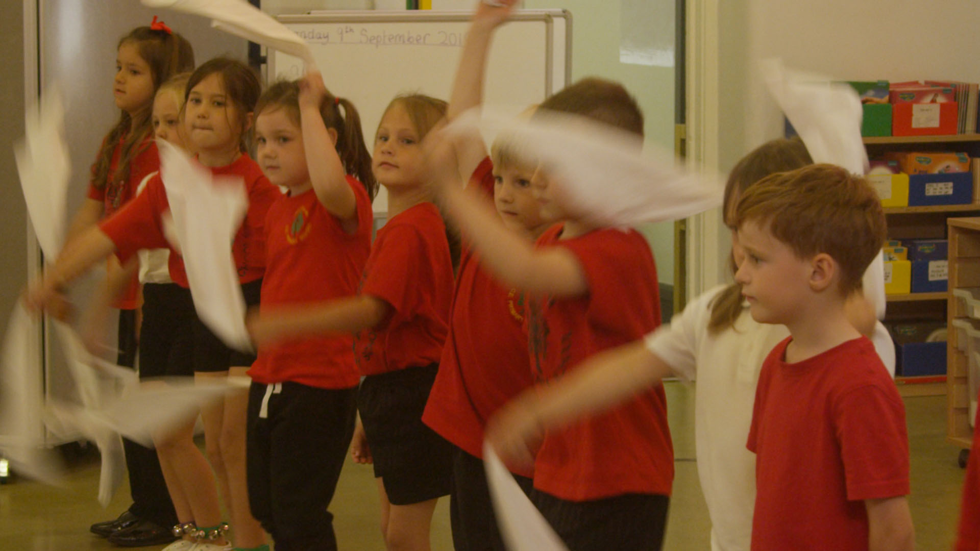 School children performing morris dancing