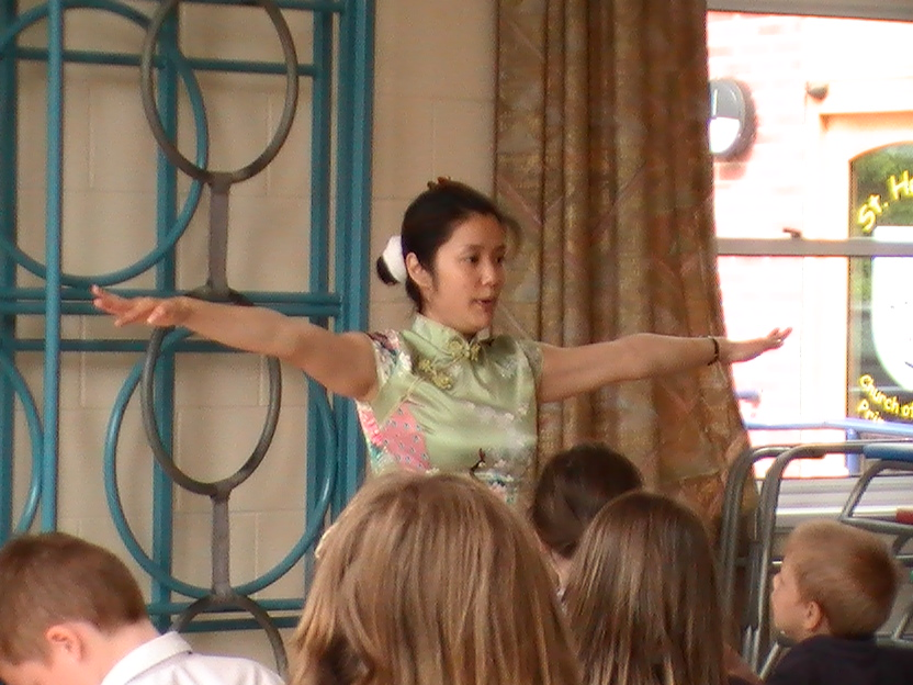 Teacher explaining how to chinese dance