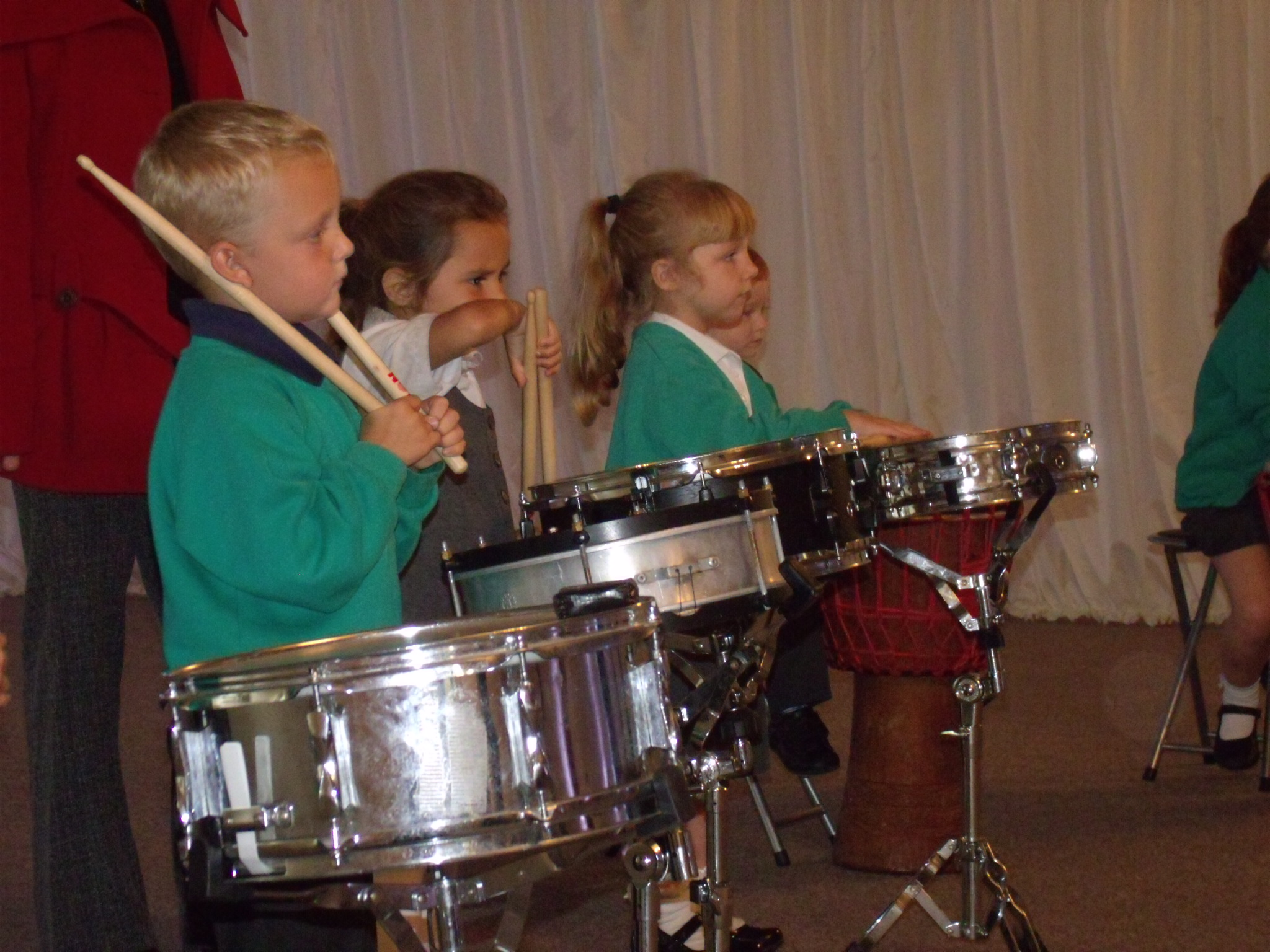 School children playing samba drums