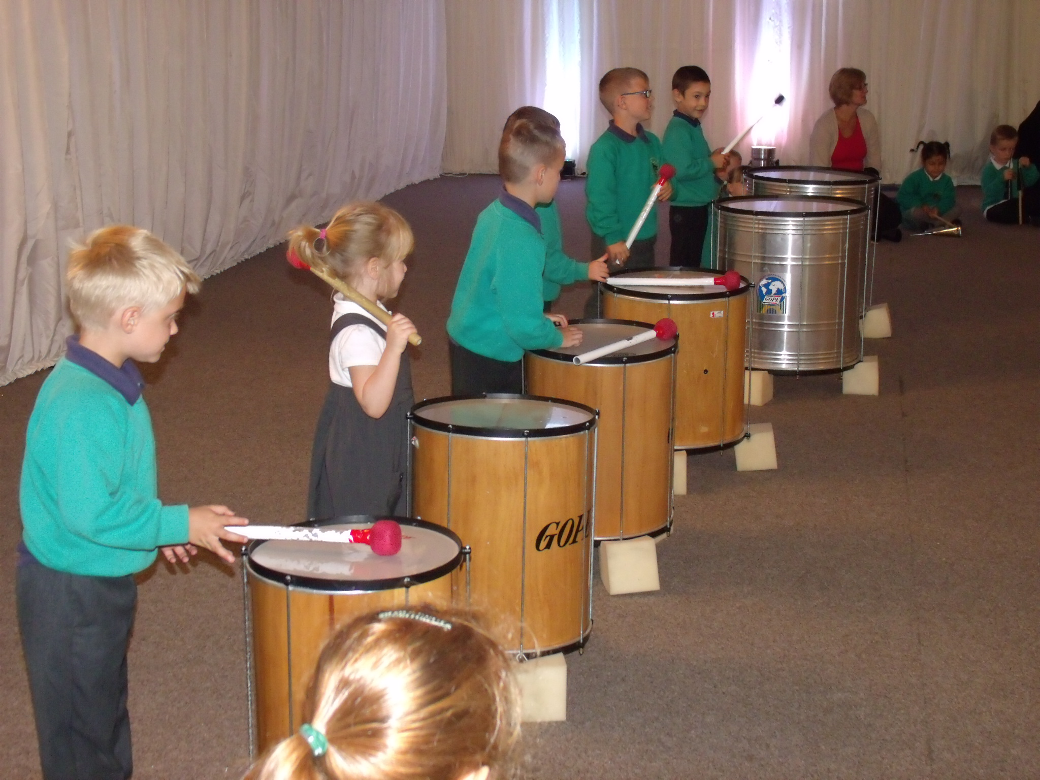 School children playing large samba drums