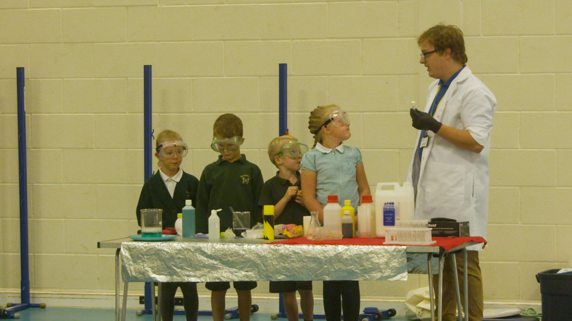 Teacher demonstrating science experiement to children