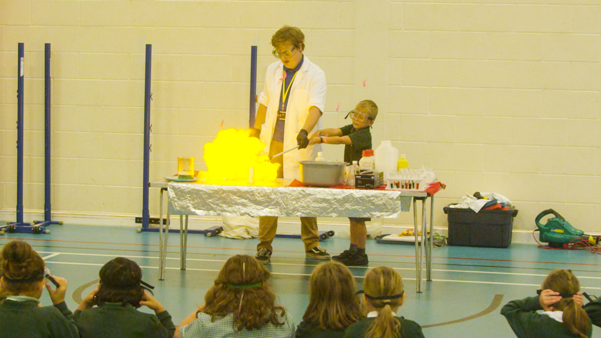 Teacher and student performing a science experiment which creates fire