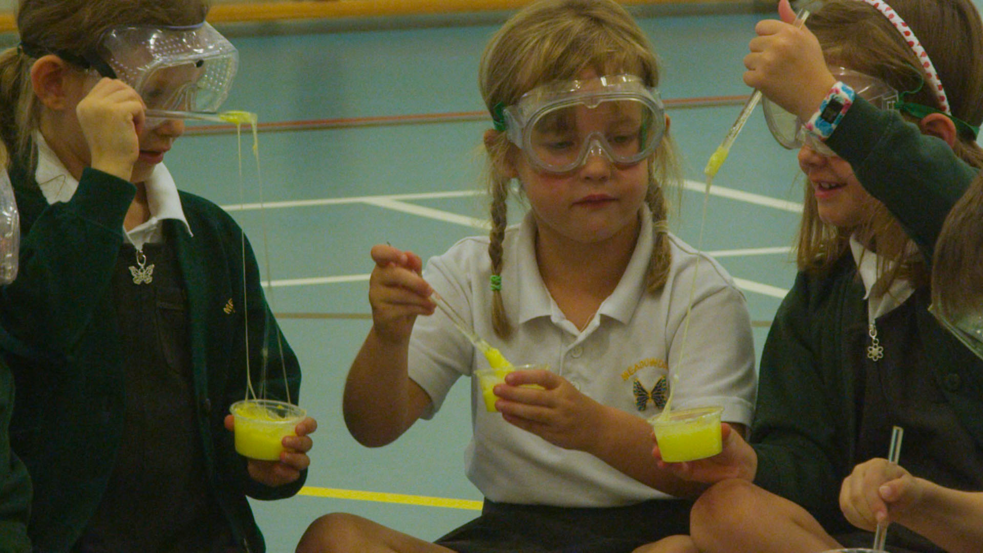 School children experimenting with science