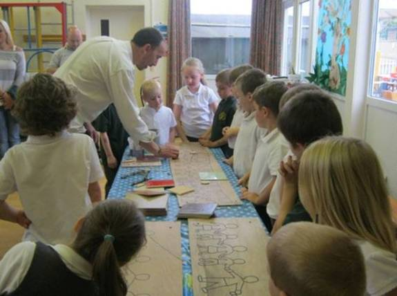 School children drawing out a design for a mosaic
