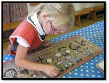 School children creating a mosaic