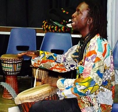 African man drumming