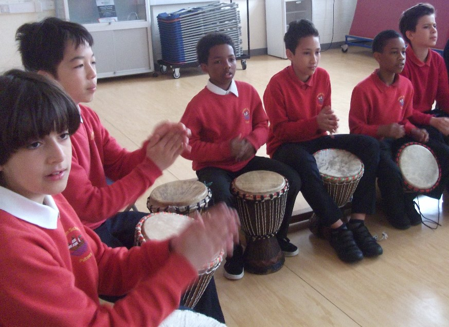 School Children with African Drums learning drumming
