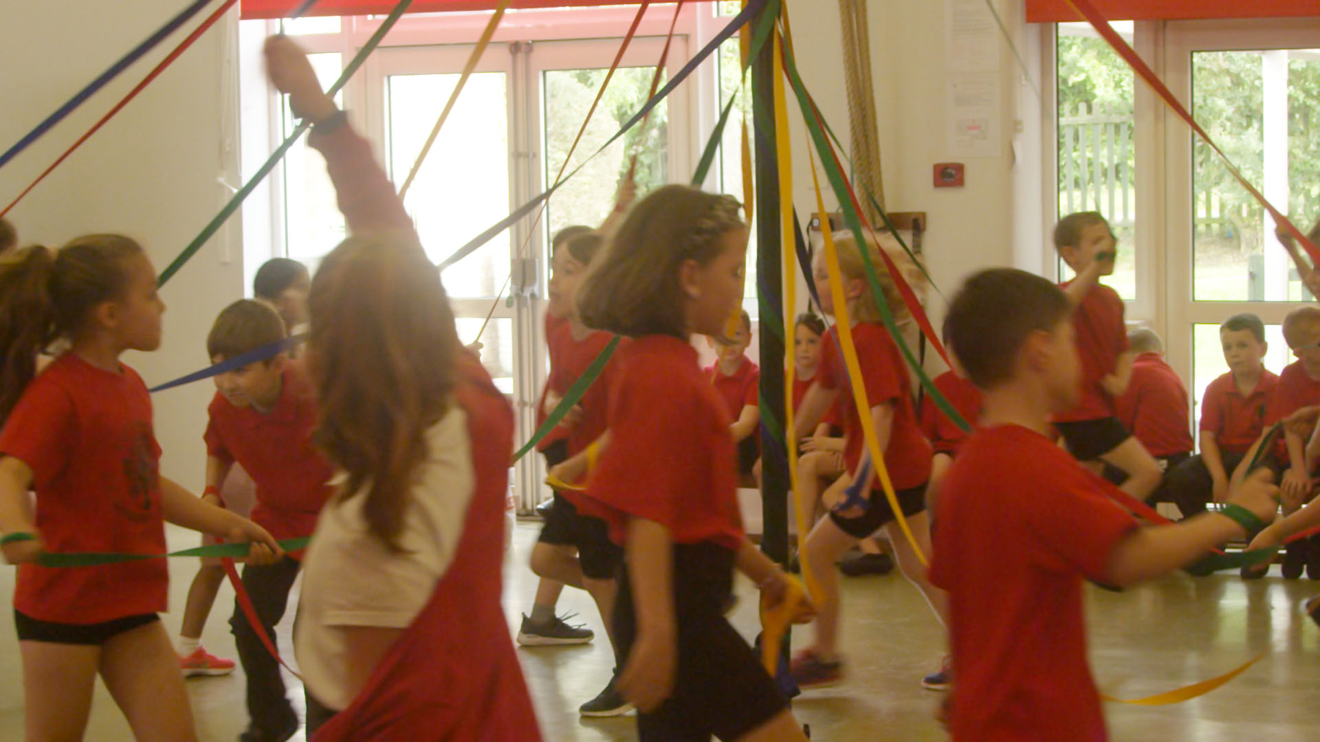 School children dancing around the may pole