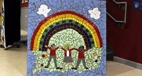 Colourful mosaic spelling out friendship with rainbow and three children