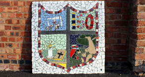 Colourful mosaic showing a school badge