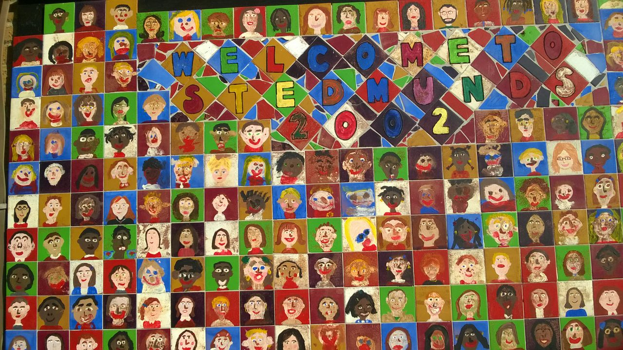 Colourful mosaic featuring each pupils face