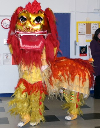 School children with red lion dance costume on